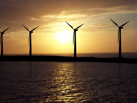 Illustrated wind turbines over a photo of sky and sea