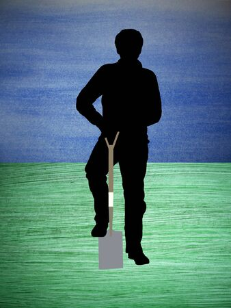 Silhouette of a man digging over a painted bluegreen surface photo