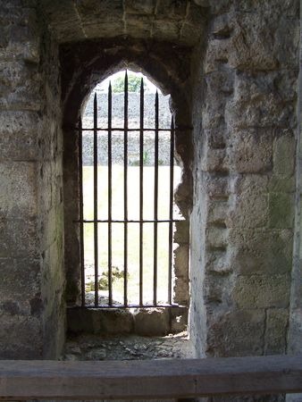 Photo of a castle doorway with iron bars photo