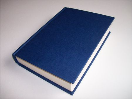 Close-up photo of a blue book on a white background Stock Photo