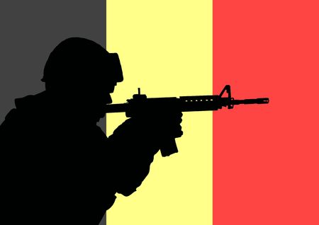 Silhouette of a Belgian soldier with the flag of Belgium in the background photo