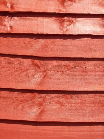 slats: Close-up photo of a stained fence panel