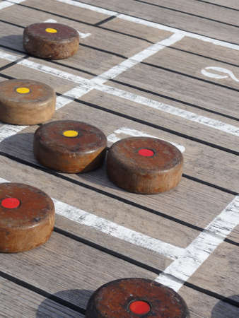 Close up photo of a Shuffle board game on a cruise ship deck Stock Photo - 12322698