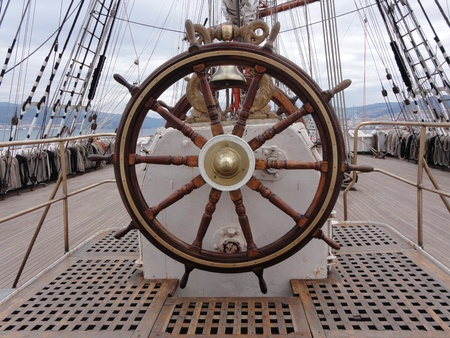 a wooden and brass ship wheel