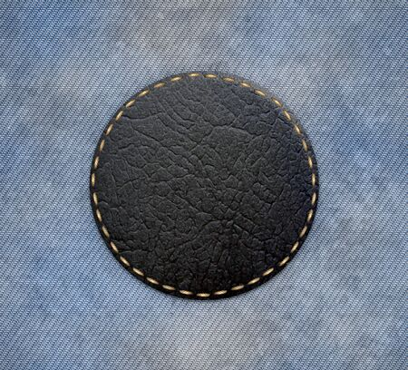 stitched: Illustration of a patch stitched to a denim background Stock Photo