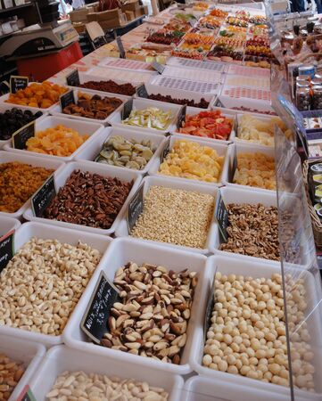 A variety of fruits and nuts being sold on a street market stall photo