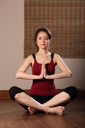 Young oriental woman meditating eyes closed photo