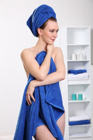 implied: Healthy woman wearing towel on body and head
