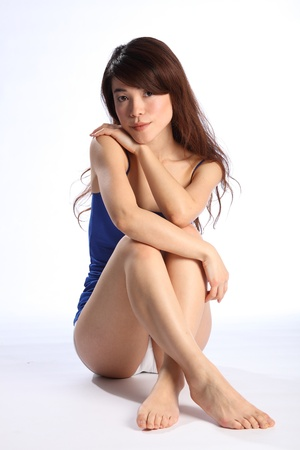 Beautiful healthy young oriental girl bare foot