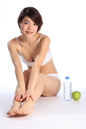 Beautiful Japanese girl with green apple and water Stock Photo - 9509806