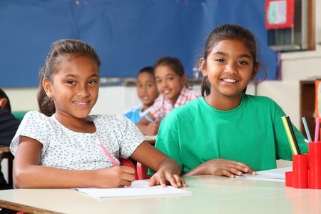 Time to learn two cheerful school girls in class Stock Photo - 9509854