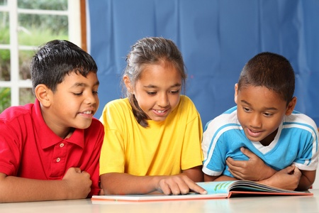 Learning together three happy young school kids Stock Photo - 9509862