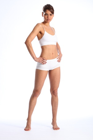 briefs: Fit young woman standing in white sports underwear