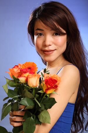 beauty shot: Beauty shot young Japanese girl holding flowers