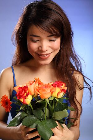 Beautiful young Japanese girl receives flowers photo
