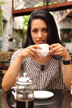 Beautiful girl enjoying quiet cup of coffee photo