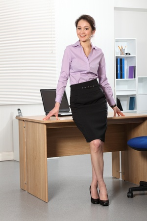 sexy business woman: Beautiful Asian business woman standing in office