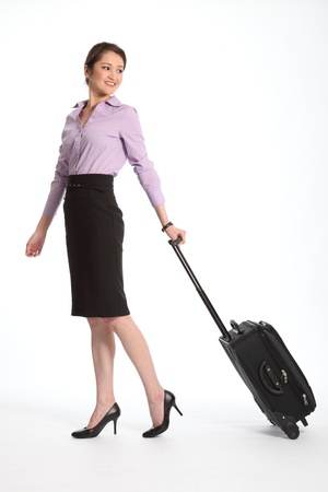 Asian business woman travelling with suitcase Stock Photo - 9509867