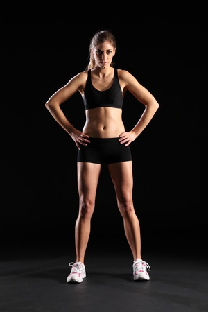girl bra: Fit young woman standing in black sports outfit Stock Photo