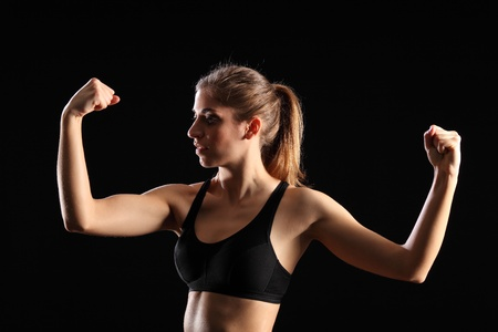 flexing: Fit woman flexing muscles during exercise workout
