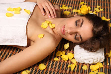 Beautiful woman lying in health spa asleep photo