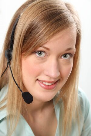 Blonde customer service woman on telephone headset photo