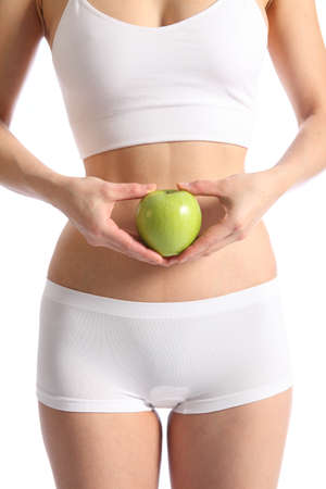 briefs: Healthy body of a woman in white underwear holding apple