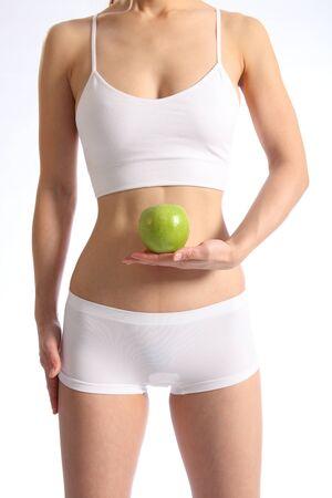wit ondergoed: Gezonde vrouwelijke torso witte ondergoed holding appel