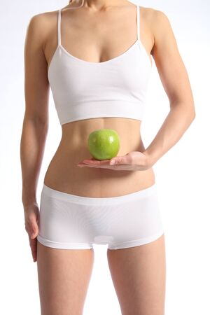 Healthy female torso white underwear holding apple photo