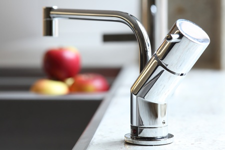 sink: Stylish home interior sink tap and red apples Stock Photo