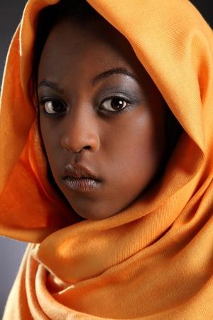 Beautiful young black girl wearing headdress photo