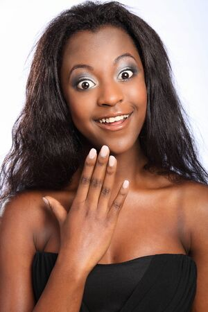 Beautiful happy young black girl with huge smile photo
