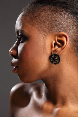 Profile portrait of beautiful black african woman photo