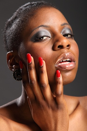 Red nails portrait of beautiful black woman photo