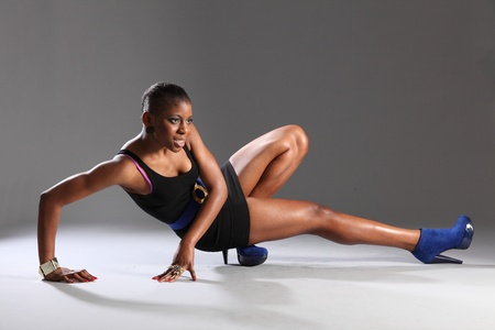 Sexy black fashion model dramatic pose in studio photo
