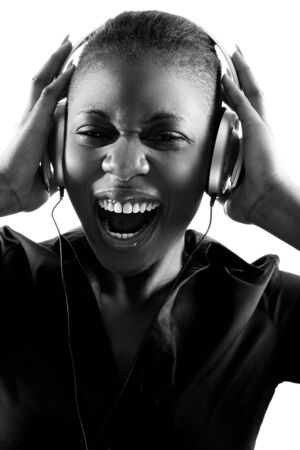 Black woman singing to music on headphones photo