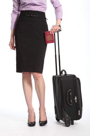 Travelling business woman with suitcase and passport photo