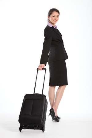 Business woman with carry on luggage photo