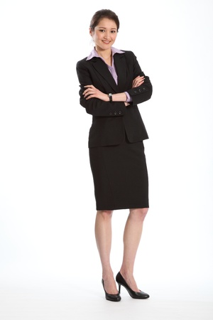 suit skirt: Career woman in black suit arms folded Stock Photo
