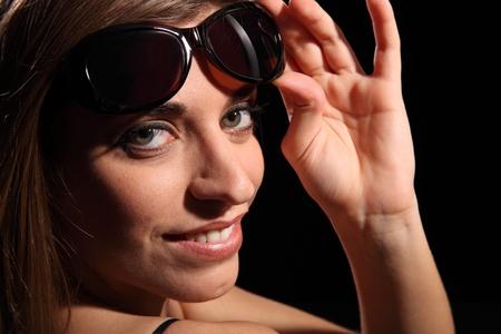 Beautiful smiling woman wearing dark sunglasses photo