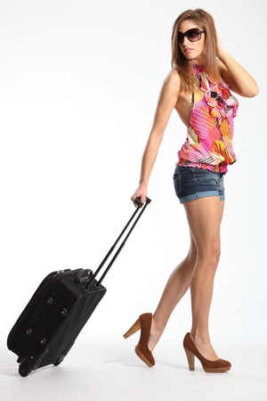 girl in shorts: Sexy long legs of woman going on holiday with suitcase