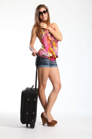 denim shorts: Ready for a holiday woman standing with suitcase