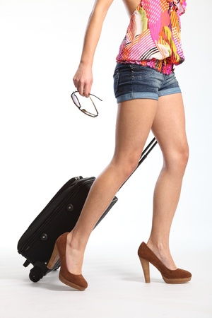 Sexy long legs going on holiday with suitcase photo