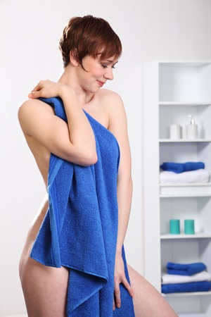 girl in shower: Beautiful healthy woman holding towel Stock Photo