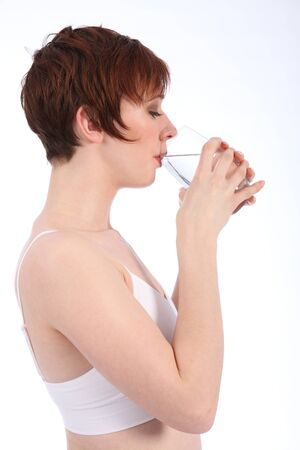 Young woman having a drink of water photo