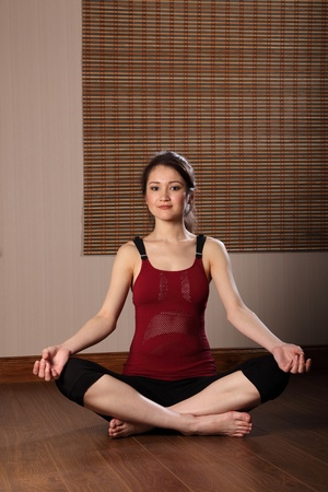 Beautiful young oriental woman meditating photo