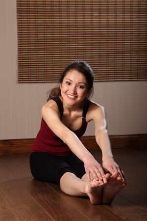 Beautiful oriental woman in stretching exericse photo