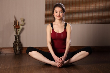 Beautiful asian woman in warm up stretch exericse photo