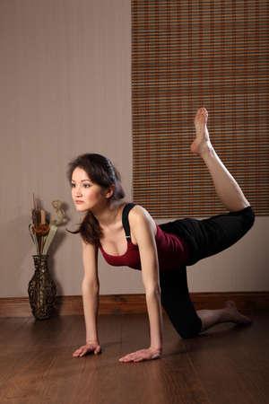 Sexy Asian woman in aerobic exercise routine photo