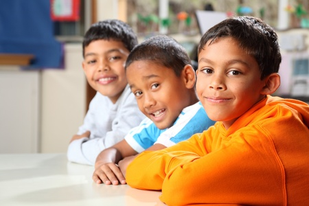 Smiling primary school friends together in class Stock Photo - 9568321